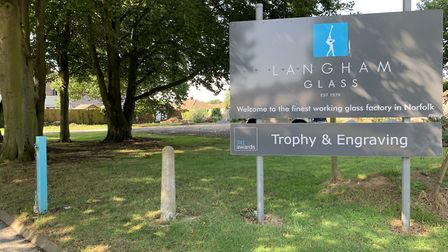 The entrance sign to Langham Glass, in front of the area where the homes are proposed PICTURE: Matth