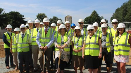 Bill Borrett and Karen Ward, representing the county and district councils, break ground with their