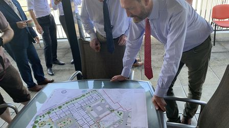 Councillors Tom Fitzpatrick and Bill Borrett take a look at the site plan PICTURE: Matthew Farmer