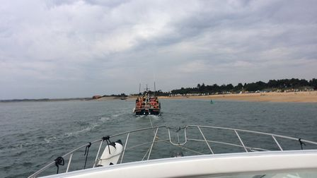 A photo, taken from Janolian, of the lifeboat towing her in. Picture: supplied by John Mitchell