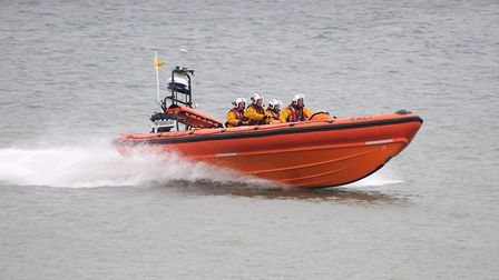 Crews from Sheringham and Wells RNLI rescued a couple after their power boat suffered engine failure