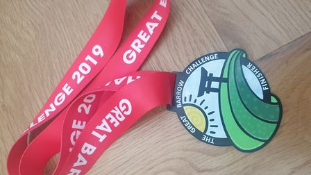Medals from Ian Odgers' latest Great Barrow challenge. Pictures: Supplied by Ian Odgers