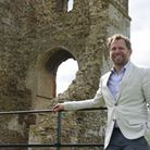 Owner James Garner at the tower from the ruins of All Saints Church at the new visitor trail around