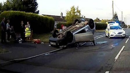The flipped car on Norwich Road, between Smiths Lane and Walnut Grove PICTURE: Contributed