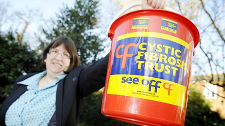 Fundraiser Sharon Moore with her trusty bucket, raising nearly £30,000 for Cystic Fibrosis Trust in