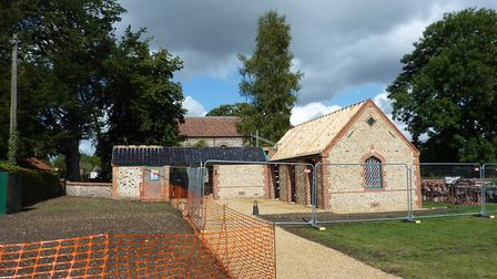 The new William Martin Building at St Andrews in Great Ryburgh with the small gas house on the left
