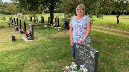 Lynda Woodhouse with the grave of her former husband, Barry PICTURE: Matthew Farmer