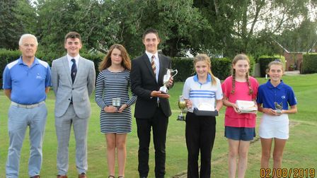 Dereham Golf Club Junior Open prize winners are pictured with the club captain Mike Pincott Picture:
