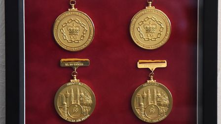 A few of sport shooter Mick Gault's 18 Commonwealth Games medals, from Kuala Lumpur, which are on di