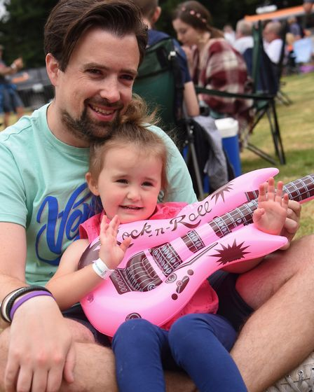 Hannah Jackson, three, joining in with the music at the Reepham Festival with her dad Ali. Picture: