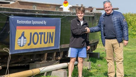 Ash Faire Ring, left, is restoring Growler in Burnham Overy Staithe, with sponsorship from Jotun. Pi
