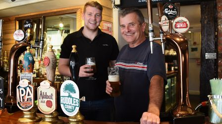 Nigel Barton, right, the new tenant at The Bull pub in Dereham, with barman Ruben Copsey. Picture: D