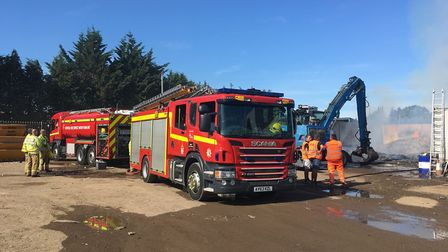 Several fire crews battled a large blaze at the Pips Skips yard in Hockering. Picture: Archant