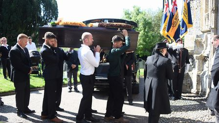 Family and friends carry the coffin at the funeral of stock car racing legend Horry Barnes at Dereha