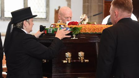 A model of a stock car is placed on the coffin at the funeral of stock car racing legend Horry Barne