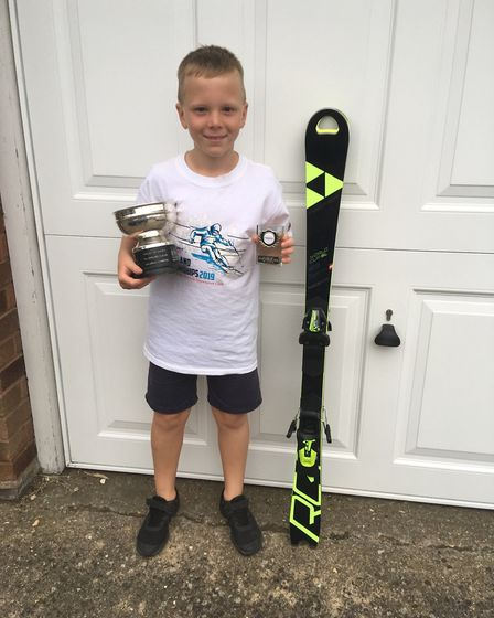Jacob Kinge, with his All England Trophy and the new skis he got after winning his category. Picture