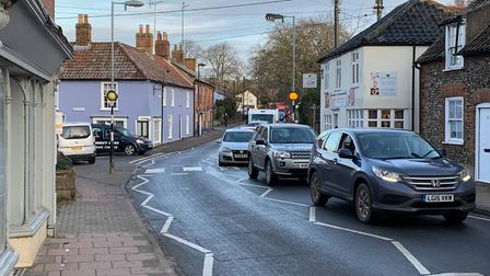 Traffic on Oak Street in Fakenham this morning as a mobile home is being delivered. Picture: Archant