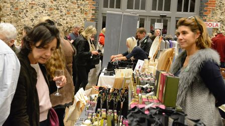 A scene from a previous Norfolk Christmas Fair at Godwick Great Barn. Picture: Supplied by Kate MacN