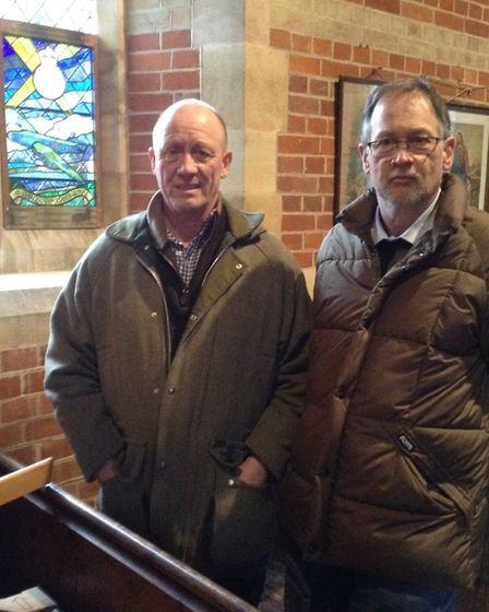 To the left is Gary Howe (treasurer) and Chris Heath (chairman) of Barney and Fulmodeston Local Hist