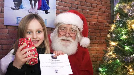 Lexi visited Santa at Dereham windmill and got herself a gift. Picture: Ella Wilkinson
