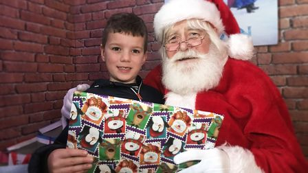 Oliver was excited about his gift he got from Santa at the Dereham Windmill. Picture: Ella Wilkinson