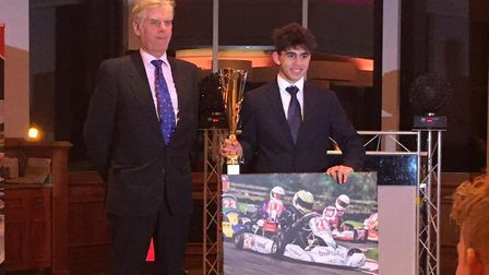 Kart racer Josh Vallance, from Dereham, receives the trophy for 1st place after becoming Whilton Mil