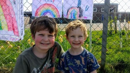 Pupils at Astley primary school creating rainbow displays for their school's railings. Picture: Astl