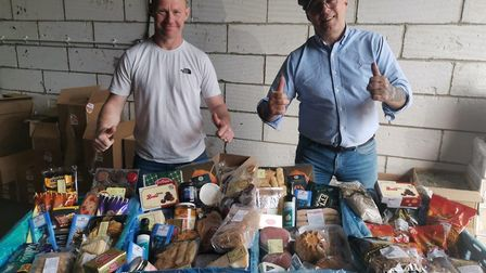 Iain Mcewan (left) and Tony Fields (right) preparing boxes for delivery across Norfolk. Picture: Ton
