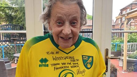 Woodspring House care home resident Jean Pilch with the Norwich City shirt and note from Delia and M