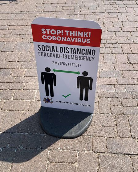 Fakenham Town Council had signs reminding people about safe social distancing. Picture: Archant