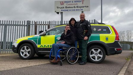 NARS paramedic Al Moore (right) with Ian and Trudy Wright outside Wright and Wright in Fakenham. Pic