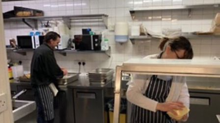 The caters at The Gallows preparing food for delivery. Picture: Claire Johnston