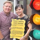 Landlords Christopher Brown and Cara Green with traffic light system installed for the loos inside T