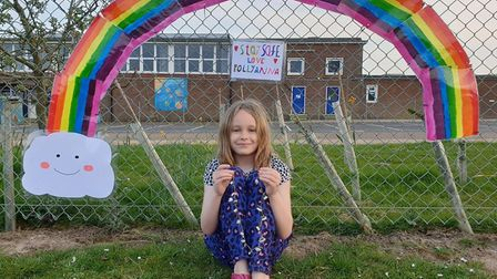 Pollyanna with her rainbow, that she pieced together with help from her family, on the school fence