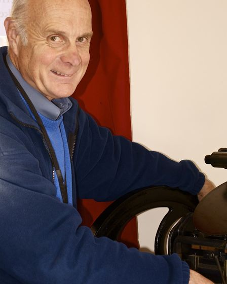 Jim Baldwin working on one of the original machines from the town's print industry
