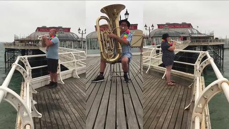 Some members of the Fakenham town band recorded at some of the footage at Cromer Pier. Picture: Cath