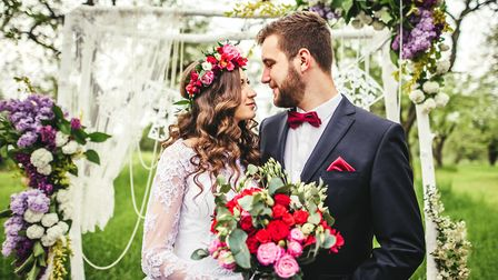 A bride and groom at an outdoor wedding. Norfolk Wedding venues say 2021 is set to be a bumper year.