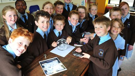 Year 4 children from The Old School, Henstead get a chance to study samples of moon rocks and meteo