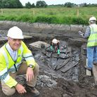 Archeologists at work on the ancient boat discovered by Environment Agency workers during the flood