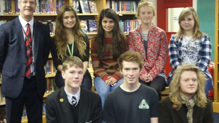Bungay High School head teacher Sean O'Neil with some of the prizewinners at the school's speech day