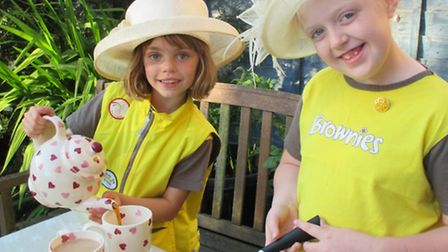 Lauren and Neve, members of the 1st Beccles Brownies, get set for their hangar tea party.