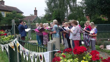 Bungay Community Choir entertain at the opening of the Bungay Festival.