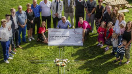 The East Anglian Air Ambulance received a cheque for £12,850 following a charity day at Halesworth G