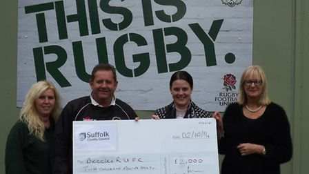 Councillor Becky Hopfensperger (second right) presenting a cheque for £2,000 to Beccles Rugby Club's