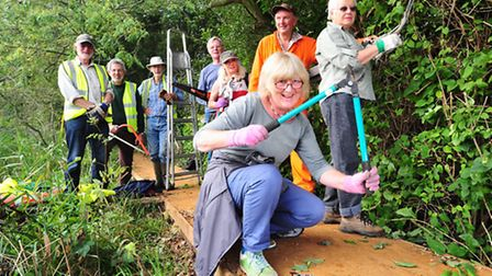 Volunteers from the River Waveney Trust association working on a new pathway along the Norfolk sid