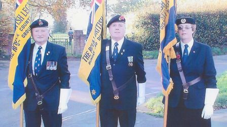 Bungay RBL standard bearer Bruce Firth-Clark, centre, with branch chairman Bob Honeywood and ladies