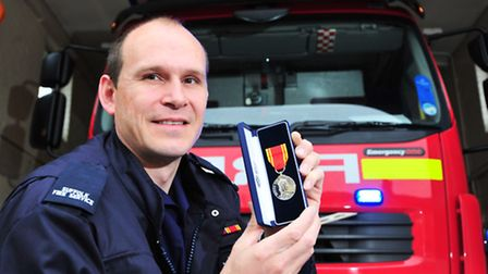 Beccles Firefighter Ian Turrell has received his 20 year long service award.