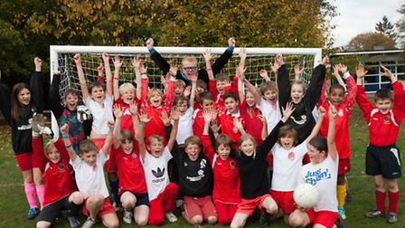 05/11/14 - Radio DJ Chris Evans with children of Weeke Primary School with one of the new football n