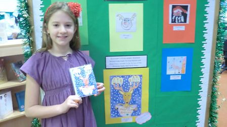 Nine-year-old Finty Woolf who won the Beccles Library Christmas card competition with her reindeer d