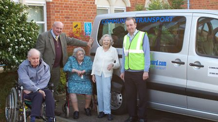 Suffolk county councillor David Richie handing over the keys to BACT volunteer driver Mark Todd with